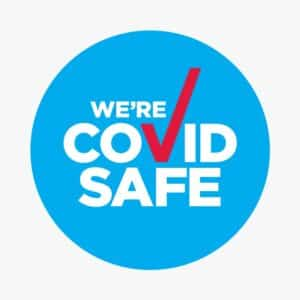 A blue sticker showing Covid Safe with a red tick