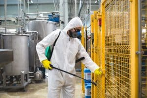 A worker conducting some pest control in a factory